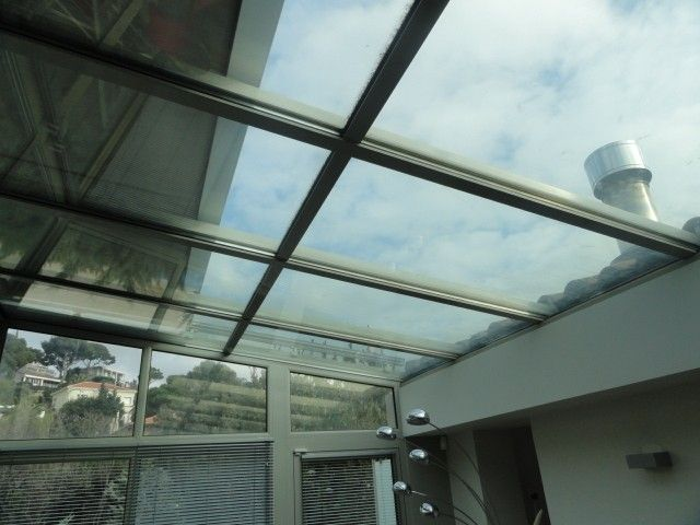 Véranda avec store extérieur de protection en toiture dans les Bouches du Rhone - Alberstore